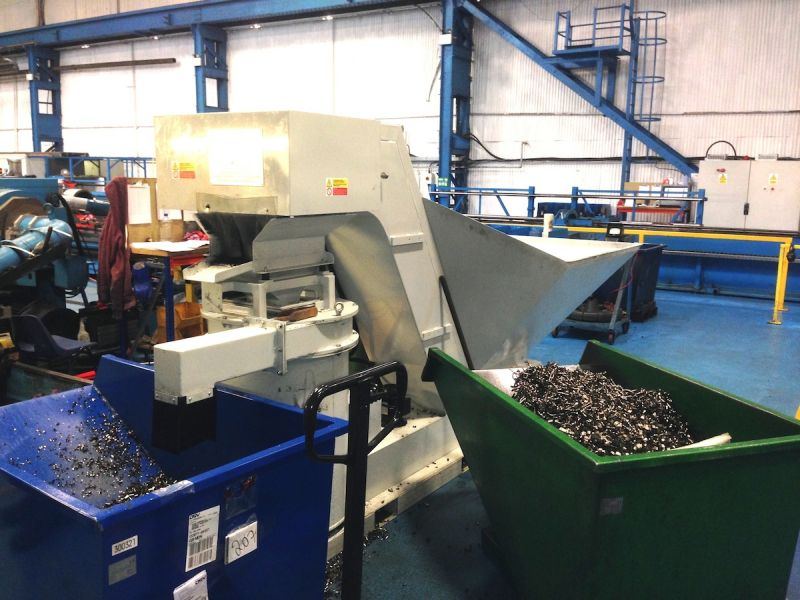 Large quantities of metal chips are produced in a high production metal working plant. By continuous removal of the chips the productivity of the plant can be improved considerably, because the machine tool operator does not waste his time removing the chips he produces as a by-product.